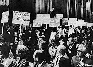 TP0553-00, Youth participants carrying placards during closing worship, 1968, Artist: